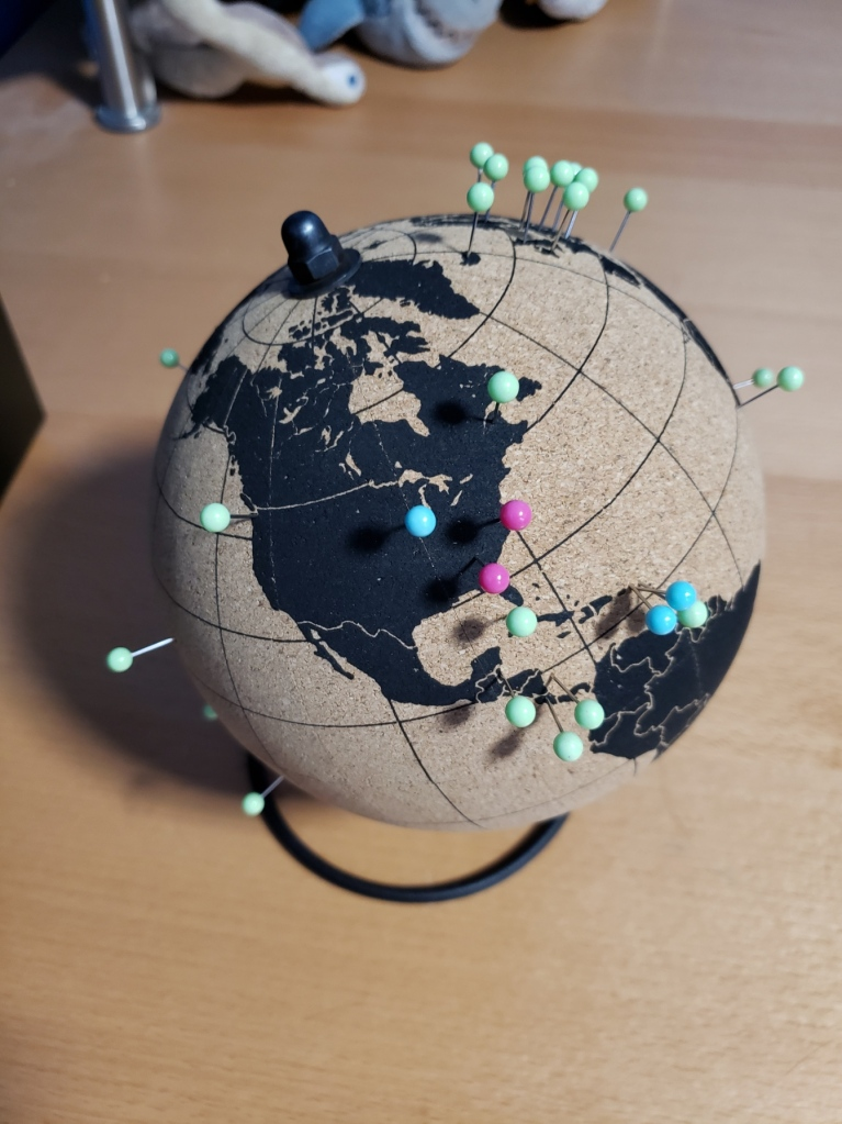 Cork board globe with colored push pins